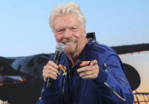 Once Sir Richard Branson (pictured at a Spaceport America conference on Sunday) was finally up in space, he posted a video of himself on board his rocket plane