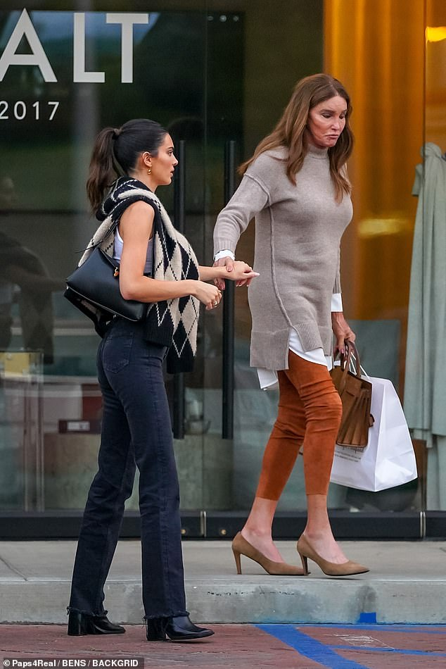 See you later: Upon parting ways with her daughter, Caitlyn squeezed Kendall's hand goodbye and left with a large white bag with her leftovers