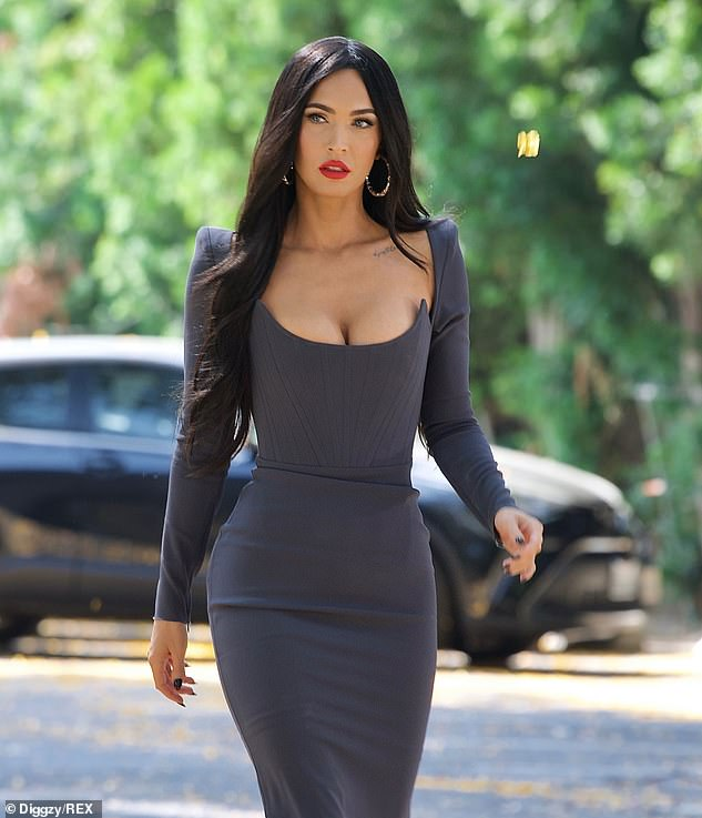 Beaming: The 35-year-old actress radiated beauty wearing a grey bodycon dress in Los Angeles after spending the weekend with her beau in Las Vegas to watch the UFC264 fight
