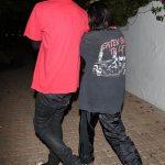Kourtney Kardashian mirrors Travis Barker's style in a slogan tee as they enjoy dinner in LA 💥👩💥