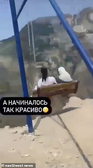 Young girls use swing in Dagestan, Russia