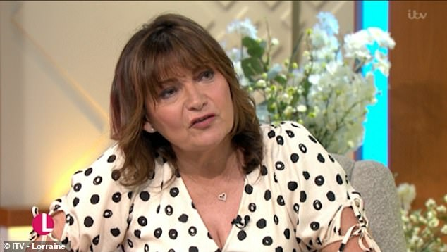 Candid:Lorraine Kelly has admitted there were times she 'should've stepped up' to racist remarks she overhead but didn't 'out of embarrassment'