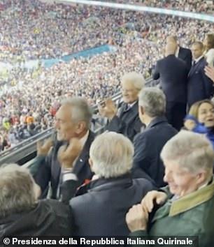 But then a man turns to congratulate the Prince, blocking his route to Sergio Mattarella