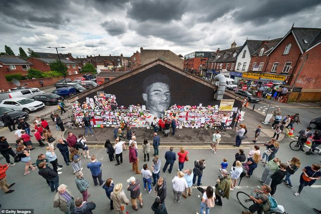 Crowds have gathered at the mural of Marcus Rashford which was repainted earlier today after being daubed with 'racist' graffiti in the wake of his Euro 2020 penalty heartache
