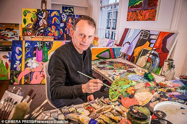 Although Marr (pictured in his studio) has almost fully recovered, he still worries about long Covid