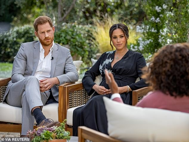 Shock:Prince Harry and Meghan Markle's explosive Oprah interview was met with boos when a clip was aired at Thursday's National Television Awards