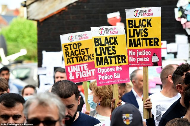 The group, Stand Up To Racism, held the demonstration at the mural on the wall of the Coffee House Cafe in his home town of Withington, Manchester