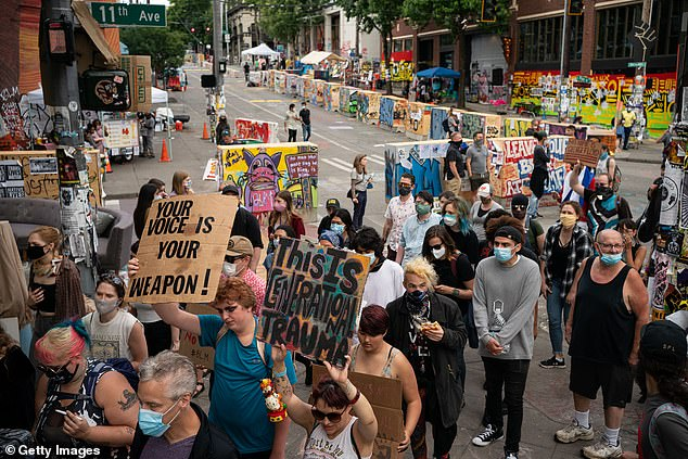 Protesters march through the area known as the Capitol Hill Organized Protest (CHOP) in Seattle on June 24, 2020, at the height of the BLM protests