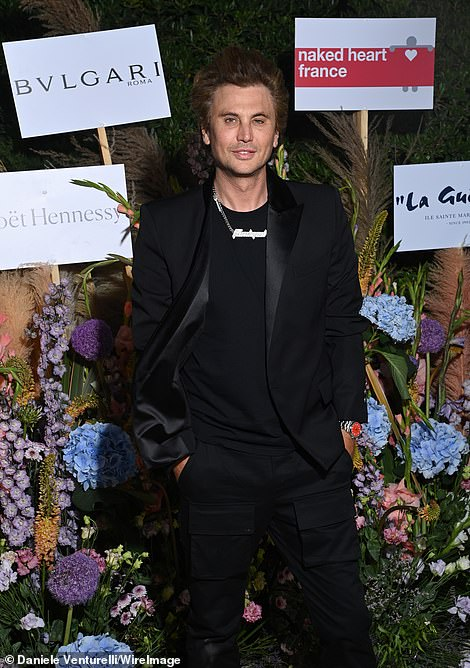 Uh oh! Kim Kardashian's pal Jonathan Cheban, The Food God, was also invited to the charity event in Cannes, beaming from ear to ear as he posed for pictures in an all-black ensemble while looking a little windswept