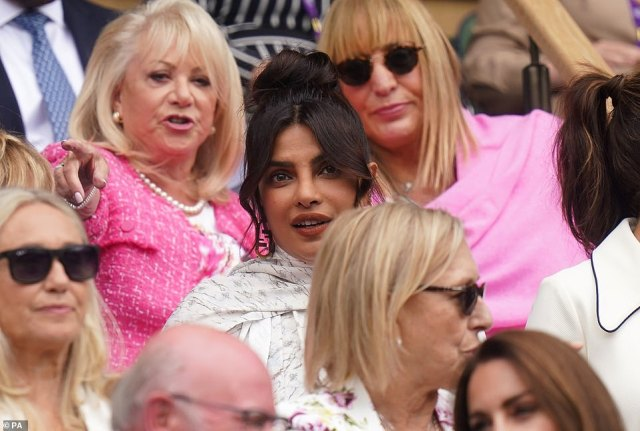Priyanka was seated in the Royal Box beside a friend a couple of rows behind Prince William and Kate - Meghan's brother-and-sister-in-law
