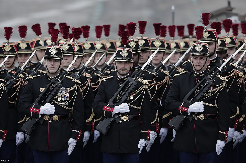 While that optimism was widely felt in France a few weeks ago, clouds have returned to the national mood as the delta variant fuels new infections and prompted Macron to announce new vaccine rules this week. Pictured: Members of the Republican Guard march in formation on the Champs Elysees prior to the Bastille Day parade