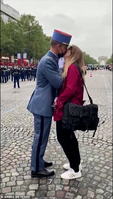 His girlfriend said yes and the happy couple kissed