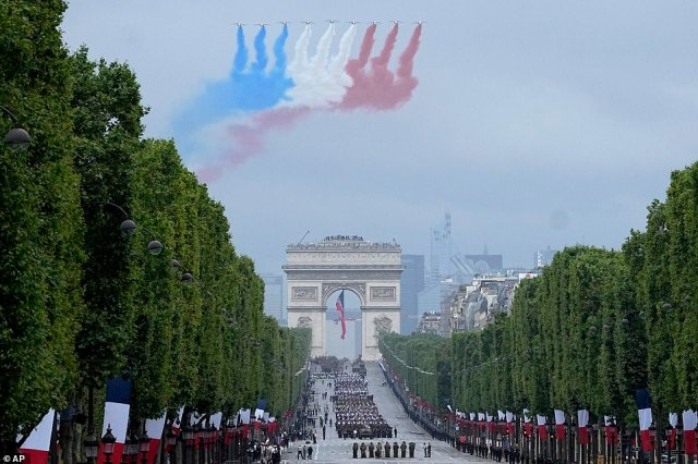 Jets of the Patrouille de France fly over the Champs-Elysees avenue during the Bastille Day parade