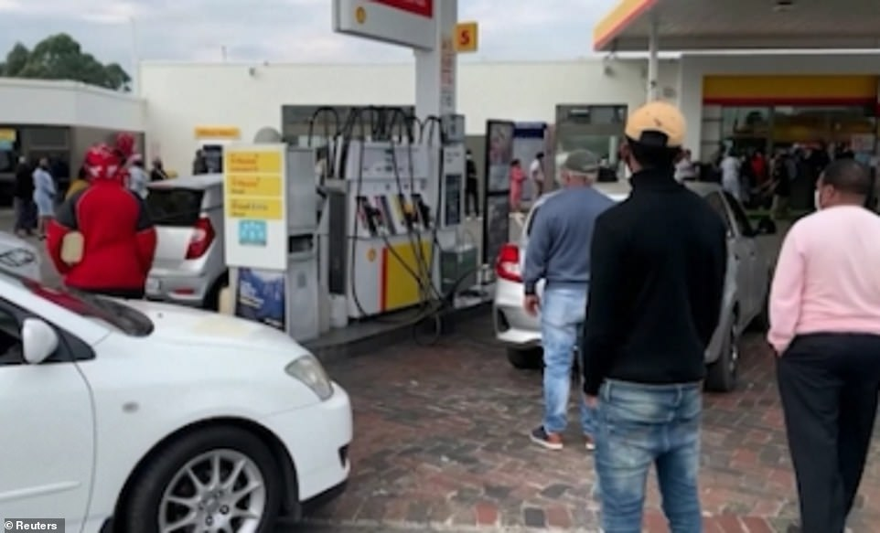 People queue up outside a Shell garage amid fears of fuel shortages