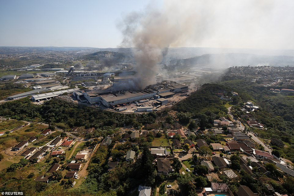 A burning warehouse in Durban on Wednesday not far from a leafy neighbourhood whose residents are terrified of the growing crisis