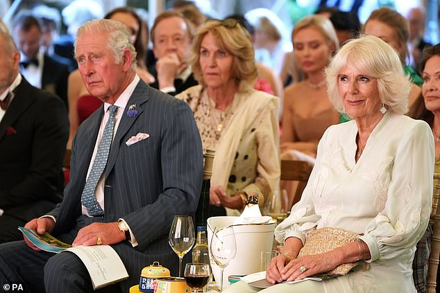 Camilla (pictured right) looked effortlessly elegant in a pale green Anna Valentine three quarter-length tunic and trousers