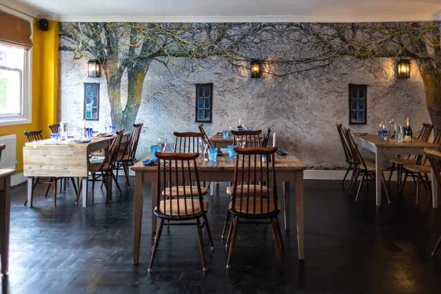 Chef-patron Mark Hartstone serves gourmet dishes from a locally sourced menu. Pictured is the dining room and itsProvencal printed mural