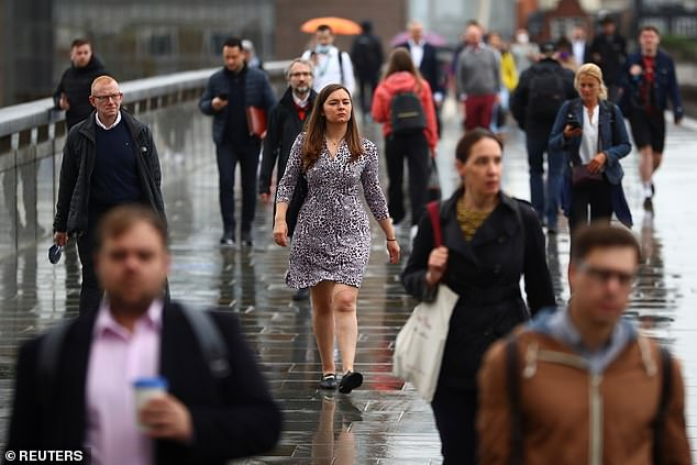 WFH limits your chance of promotion, and with men in the office, their careers will advance at a huge cost to female equality (file image of commuters on London Bridge)