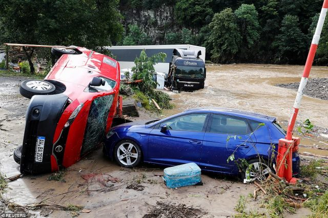 Cars destroyed by flood are pictured on a flood-affected area, following heavy rainfalls in Schuld, Germany