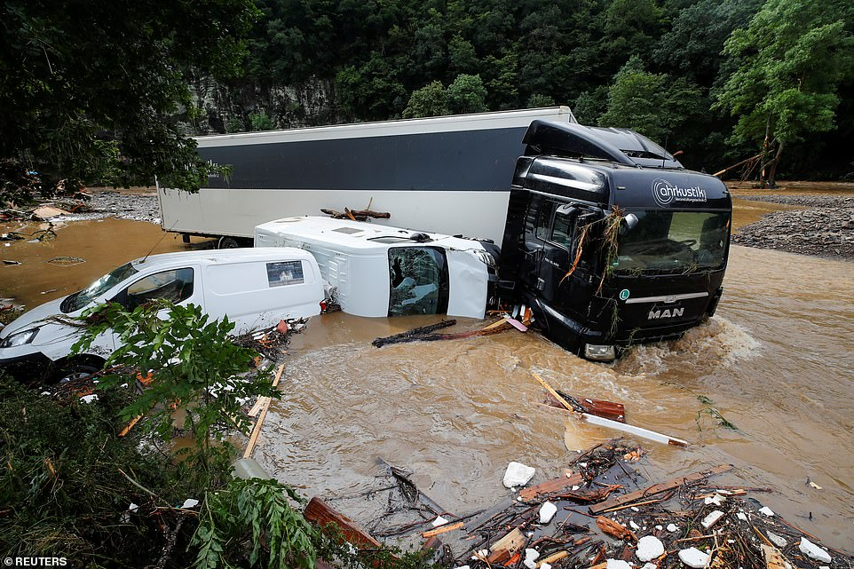 Partially submerged vehicles are pictured on a flood-affected area, following heavy rainfalls in Schuld, Germany