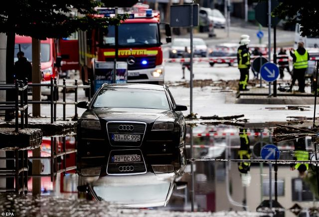 Emergency crews join the cleanup operation after downpours overnight in Hagen, Germany, triggered flash flooding