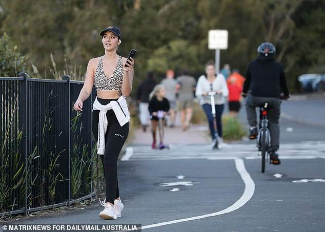 The Premier begged people to stay away from local drug stores and doctor's surgeries if they feel ill to avoid spreading the disease further. Seen here is a woman exercising on Sydney's Bay Run