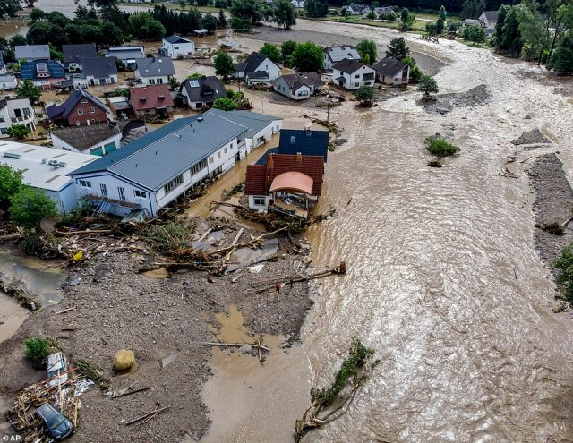Damaged houses are seen along the Ahr river in Insul, western Germany, after it broke its banks overnight