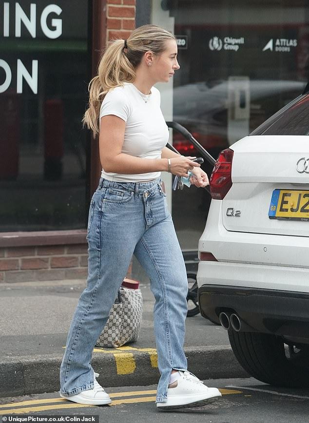Homeward headed: She was seen getting into her own swanky car