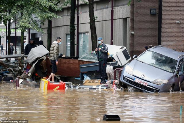 Damaged cars on a flooded street in the Belgian city of Verviers