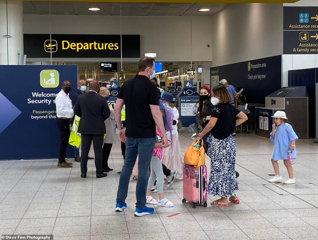 Travellers are seen at Gatwick Airport on Wednesday, before the changes were announced by Transport Secretary Grant Shapps