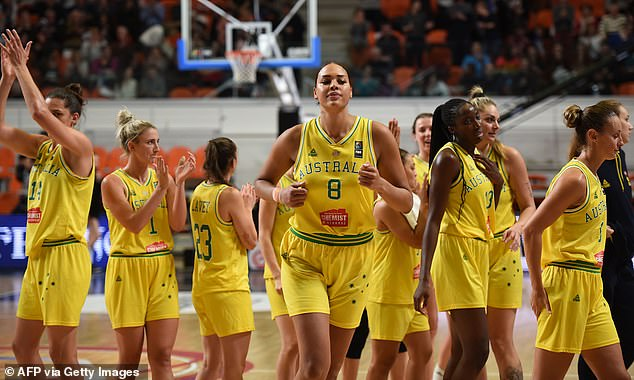 Liz Cambage (centre) will be sorely missed by the Opals in Tokyo - she is regarded as the team's best player