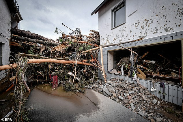 Trees, broken pieces of concrete and other debris block a road in the village of Schuld, Germany, as the true extent of flooding damage becomes clear