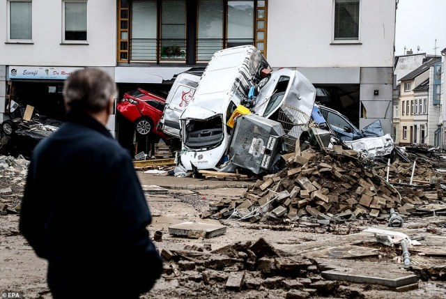 A local surveys the damage caused by flooding inBad Neuenahr, in Ahrweiler district, where most of the missing hail from