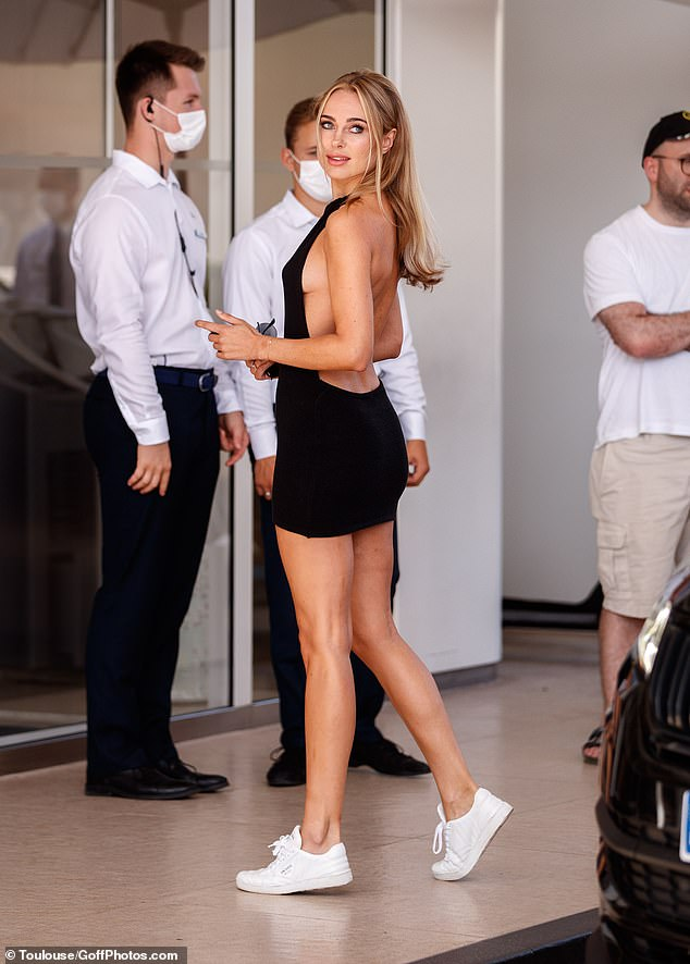 Stunning: Kimberley Garner, 30, wore a black halter neck dress, flashing a glimpse of side boob on Friday as she left the Hotel Martinez