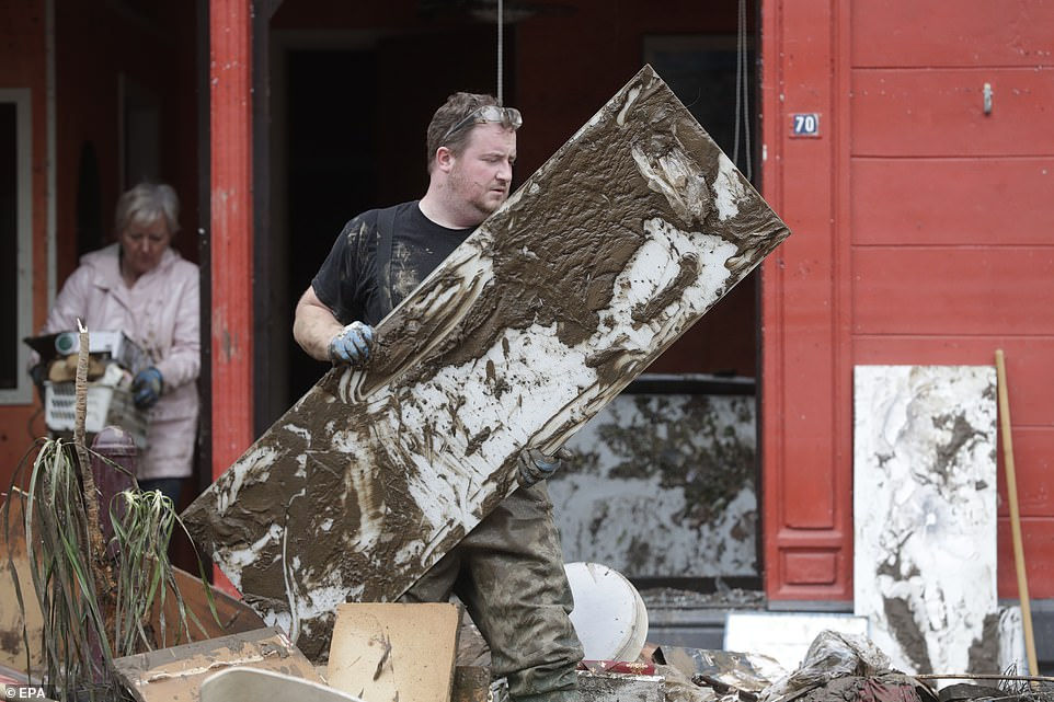 Residents clean up after heavy rains caused severe flooding in Ensival, Verviers, Belgium