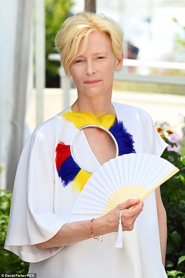 Style: Tilda's floaty white blouse was adored with colourful feathers on one side and it featured a silver ring that was stitched into the fabric