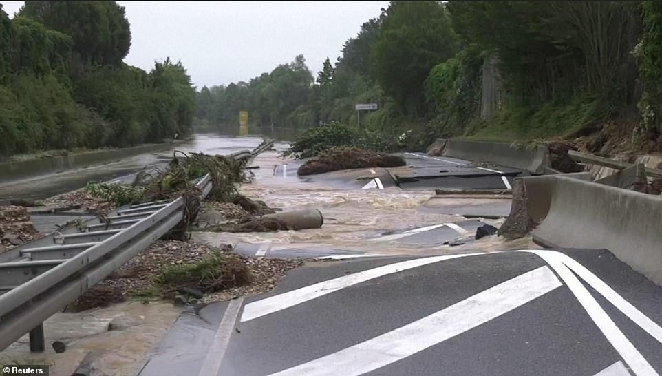 A road is completely destroyed near Blessem, Germany, after landslides caused by flooding