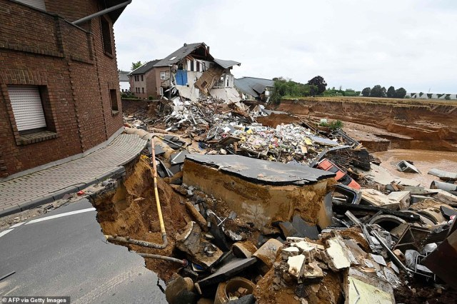 Houses on the outskirts of Blessem were torn to pieces as the ground beneath them collapsed and fell into a nearby gravel pit in the wake of torrential rains that have caused chaos in western Germany
