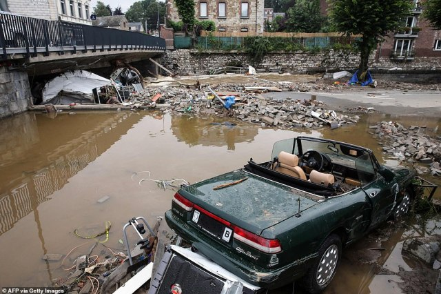A damaged car and rubble caused by the floods in Theux, near Liege, in Belgium