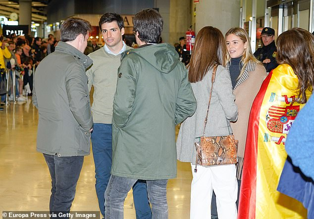 While there aren't any loved-up snaps of the couple together, Isabel has shared photos with his team during Grand Prix weekends, and was pictured at Adolfo Suarez Barajas Airport in Madrid waiting for Carlos with his family after he won his third Dakar Rally title on January 19, 2020 (pictured)