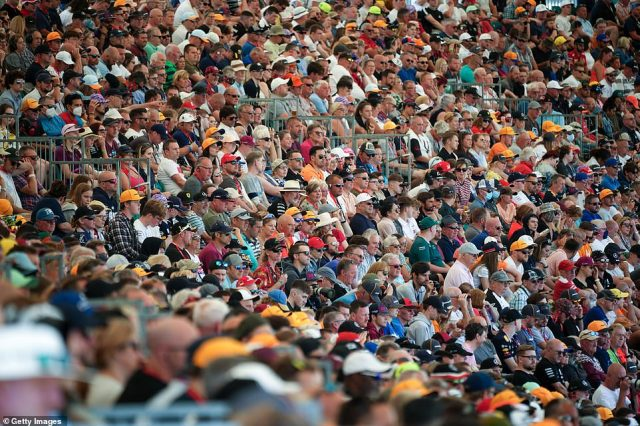 Motor racing fans soak up the atmosphere during Friday Practice at the British Grand Prix at Silverstone