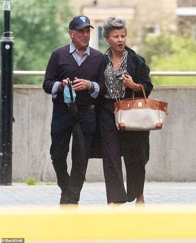 Dinner time: Tracey Ullman, 61, put on a glamorous display wearing suit trousers and a buttoned shirt as she headed to dinner with a mystery man in London on Thursday