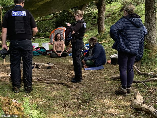 Devon and Cornwall Police's attempts to move the hippy ggroup on descended into farce when officers gave in to demands on how to address them - by agreeing to use a 'talking stick'