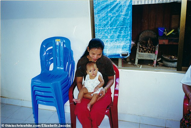 According to Jacobs, the documents show discrepancies, with orphanage papers showing one birth date and government documents showing another (pictured with her Cambodian nanny)