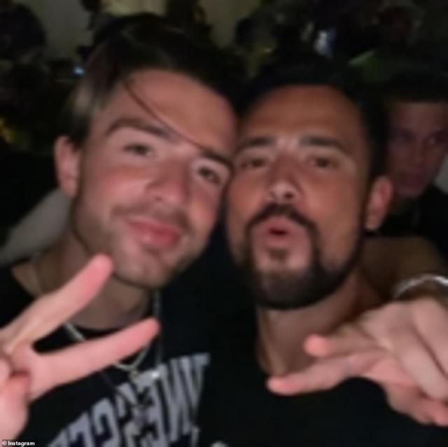 Grealish (left) was also seen partying with Denzel's group, meaning he and Mount may have mixed on their Mykonos night out