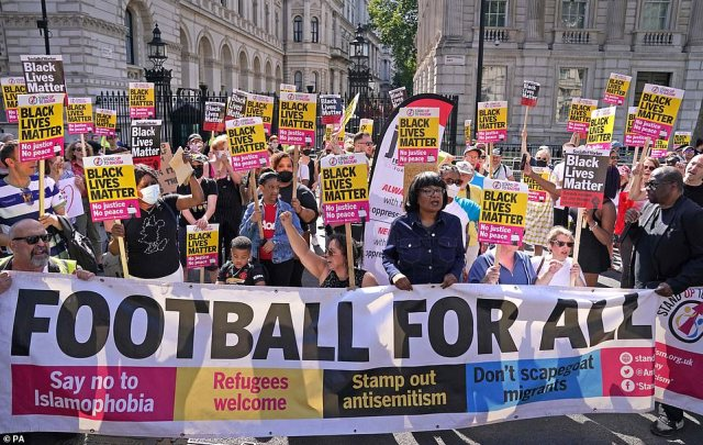 Diane Abbott (centre right) with protestors during a Stand Up to Racism taking the knee event outside Downing Street today