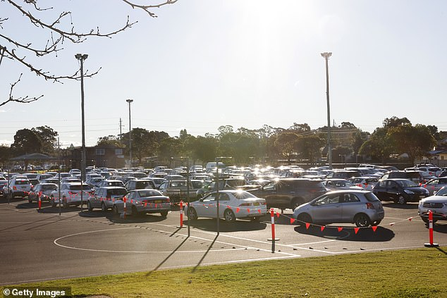 Huge rows of cars can be seen at a Covid test clinic in Sydney's Fairfield West on Sunday, as cases continue to rise in the South West