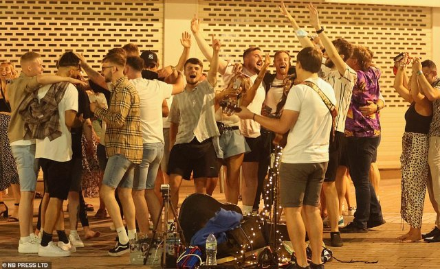 Revellers descend upon a street in Leeds and enjoy a night out just before the so-called 'Freedom Day' as the nation enjoys rising mercury levels