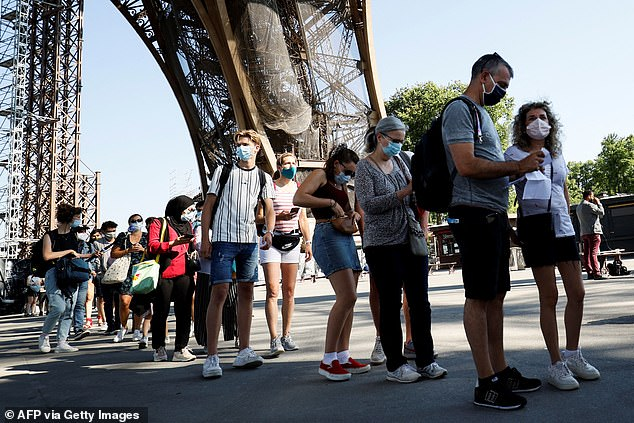 People on holiday in France (pictured, at the Eiffel Tower in Paris), or planning to go there, are told at a moment's notice that they will have to quarantine for ten days because of the South African variant
