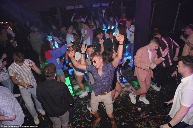 The grand re-opening has come as Covid cases across the UK soared by 52 per cent week-on-week. Pictured:Revellers get back on the dancefloor at Powerhouse nightclub in Newcastle